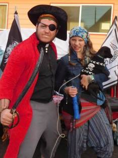 Intern Pastor Seth, Katrina, and their puppy Phoebe dressed as pirates!