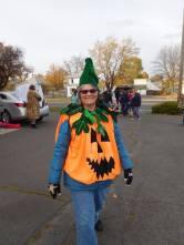 Laura dressed as a pumpkin.