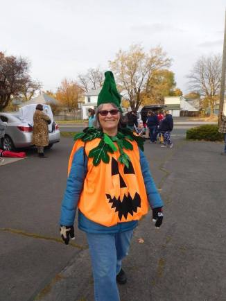 Laura dressed as a pumpkin.