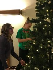 Kelsey and Kathryn Setting up the Tree