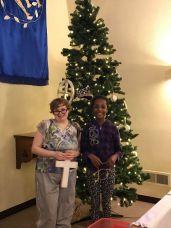 Taylor and Elsa Placing Ornaments